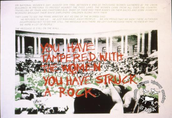 YOU HAVE TAMPERED WITH THE WOMEN YOU HAVE STRUCK A ROCK AL2446_2605  by the Community Arts Project, Cape Town. This image refers to a slogan poster that became the rallying cry of women's organizations. This image depicts women marching to government offices at the Union Buildings in Pretoria in 1956.