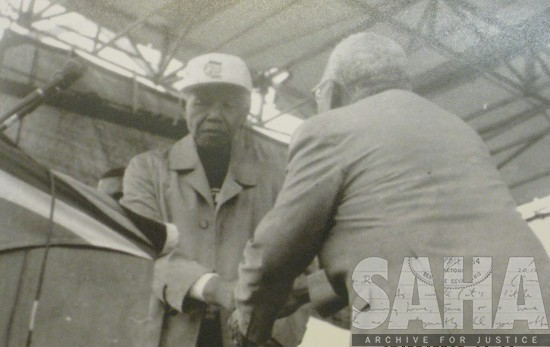 Reverend Mapheto and Nelson Mandela shaking hands, photographer and date unknown. Archived as SAHA collection AL3288_2.2.08