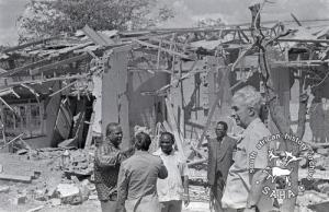 Joshua Nkomo, journalists and visitors viewing the damage after the Freedom Camp attacks