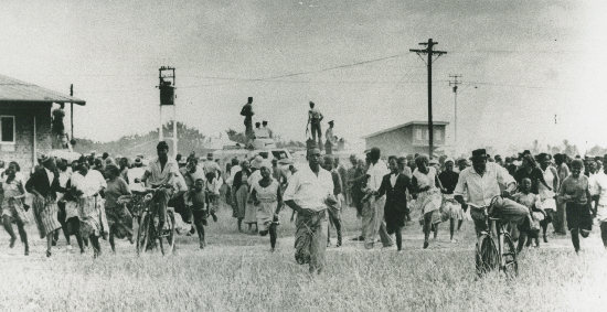 Protesters fleeing from police outside the Sharpeville Police Station on March 21, 1960.