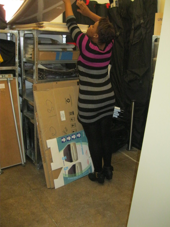 Archival assistant Nonhlanhla Ngwenya organising exhibition materials in the new storeroom, 2014