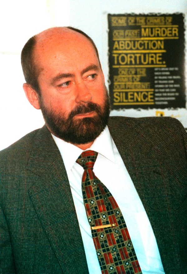 Dr Wouter Basson in front of South African TRC poster. Photograph by Eric Miller
