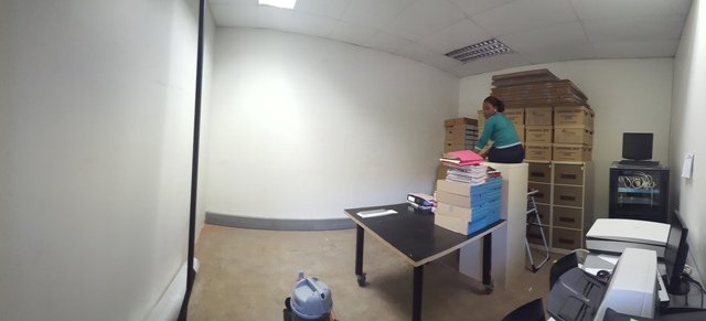 Reorganising the space in the archival sorting room during the archival refurbishment, March 2016