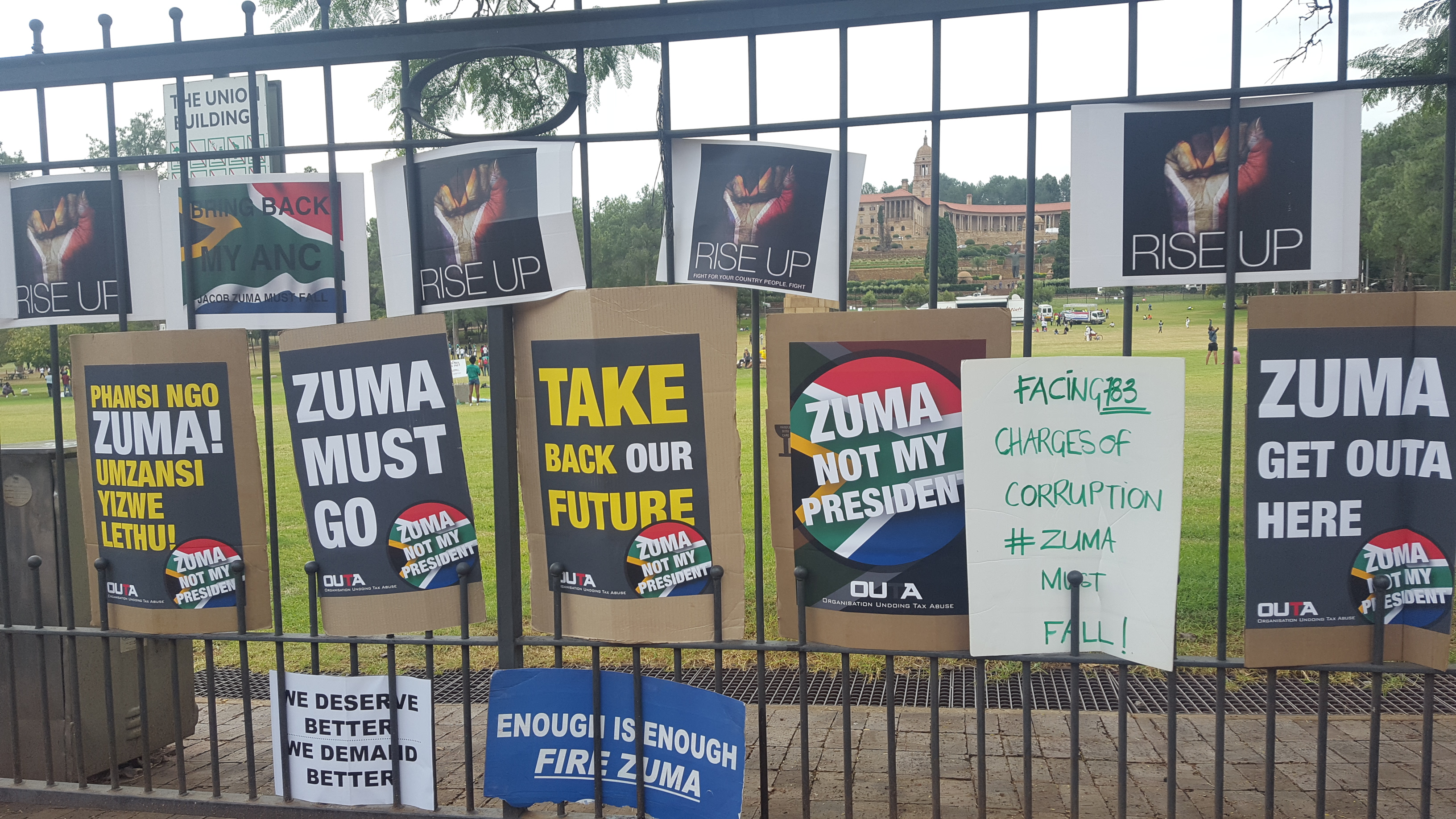 Fence with posters attached outside of union buildings