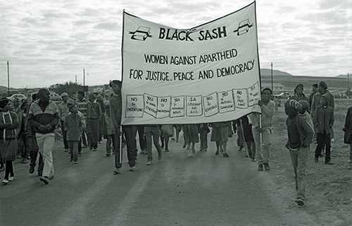 Youth marching while carrying a Black Sash banner, 1985 AL3274_C45