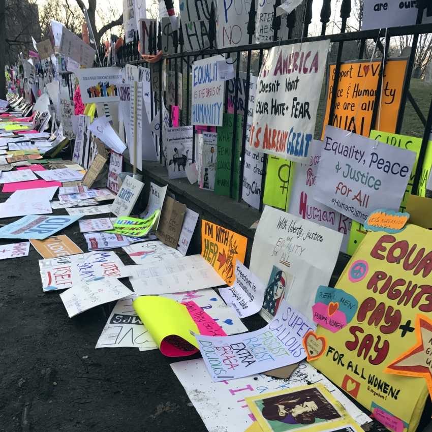 Signs line the fence surrounding Boston Common after the Boston Women's March for America on Saturday. Some of those signs could end up in an archive at Northeastern U.Dwayne Desaulniers, AP Images