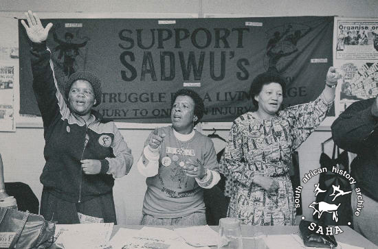 Black and white photograph of delegates at the launch of the Transvaal South African Domestic Workers Union Living Wage Campaign, taken by Anna Zieminski, September 3, 1988. Archives in SAHA collection as AL2547_11.9.10.