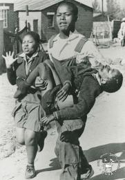 The death of Hector Pieterson This is Sam Nzima's well-known black and white photograph of the dead body of Hector Pieterson being carried by Mbuyisa Makhuba alonside his sister during the Soweto uprising on 16.06.1976. This photograph was digitised by Africa Media Online (AMO) in 2009. Included in SAHA exhibition kit and virtual exhibition - 'The Future is Ours: Commemorating Youth in the Struggle'